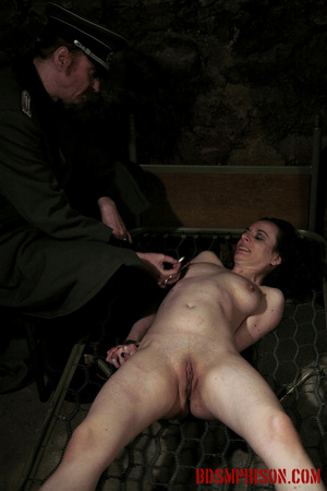 Bare honey tied to a stripped bed feels the heat from her guard's cigarettes. - XXXonXXX - Pic 6