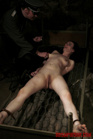 Bare honey tied to a stripped bed feels the heat from her guard's cigarettes. - XXXonXXX - Pic 9