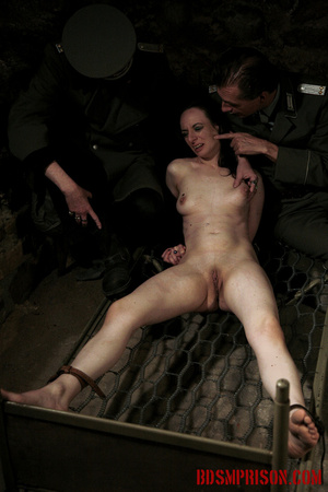 Bare honey tied to a stripped bed feels the heat from her guard's cigarettes. - XXXonXXX - Pic 14