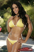 Flirtatious honey strips off yellow swimsuit to show off twin tits and