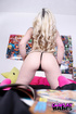 Inked blonde chick in pink stockings drilling her cunt with a vibro
