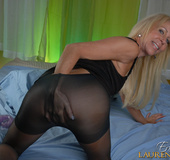 Delectable tramp rips her black pantyhose to do her cunt with dildoes