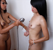 Two lesbian Thais takes a shower together and rubs then licks each others