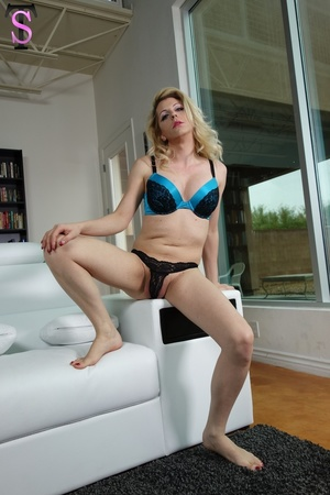Sexy shemale in blue and black lingerie  - Picture 1