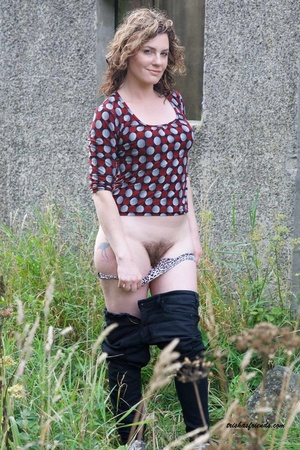 Gorgeous cougar in red and gray polka dotted shirt pulls down her blue jeans and white and black spotted panty and lets you peek at her hairy pussy outdoor. - XXXonXXX - Pic 8