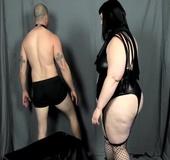 Bondage fattie wearing black lingerie, fishnet stockings and boots puts