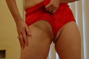 Dame in red shorts fills her pussy with  - XXX Dessert - Picture 1