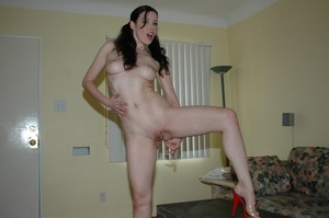 Dame in red shorts fills her pussy with  - XXX Dessert - Picture 7