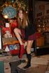 Busty long-haired teen babe in high boots showing off her delights in