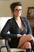 Hot secretary with glasses slowly peels off her black blouse and skirt