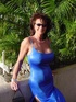 Hot brunette busty milf rocks in cute blue long gown and different sexy