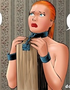 Ponytailed redhead in a collar enchained to the boot and in a special