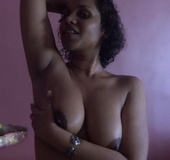 Luscious Indian babe seduces as she shows her big soft breasts while licking