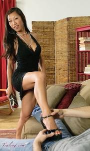 elegant asian babe seduces