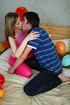 Hot young chick teases her boyfriend as she makes out with him while she