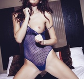 Passionate lady takes off her lovely blue outfit