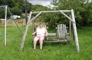 fat grandma sits wooden
