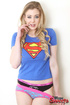 Delish babe in her superhero shirt displays her honkers on white sheets.