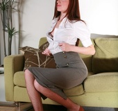 Brunette business-lady takes off her suit to pose in fishnet pantyhose