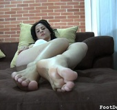 Awesome footjob presented by dominant brunette woman