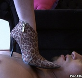 Bossy woman steps on the dude in sexy high heels before taking it off