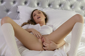 Foxy babe lays down on a white bed then  - XXX Dessert - Picture 5