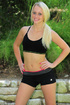 Gorgeous chick displays her banging body in black gym bra and shorts as