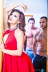 Elegant tranny seduces two hunk studs as she displays her luscious body