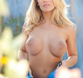 Blonde bombshell opens her blue polo and seduces with her banging body
