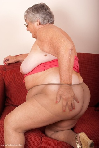 horny granny rubs pussy