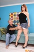 Redhead cougar slowly peels off her black tube shirt, jeans skirt and