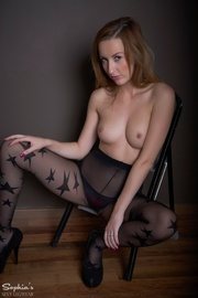girl pulls down pantyhose