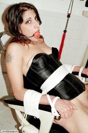 gagged slave corset gets