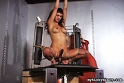 bondaged brunette gets penetrated