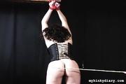 plump brunette gets bondaged