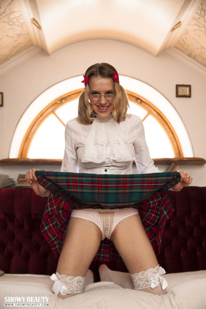 Blonde school girl wearing pigtails and glasses opens her white blouse and shows her hot tits before she removes her green and red checkered skirt and white panty and reveals her nasty crack on a maroon and white couch wearing her white stockings. - XXXonXXX - Pic 1