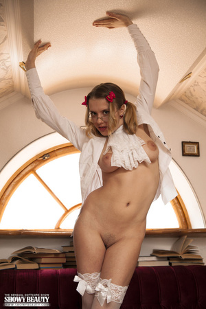 Blonde school girl wearing pigtails and glasses opens her white blouse and shows her hot tits before she removes her green and red checkered skirt and white panty and reveals her nasty crack on a maroon and white couch wearing her white stockings. - XXXonXXX - Pic 10
