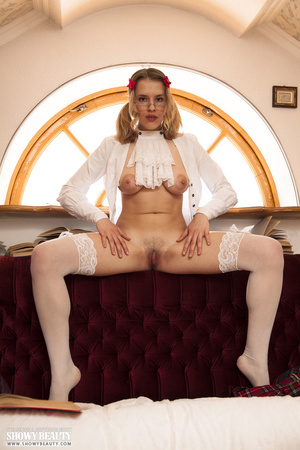 Blonde school girl wearing pigtails and glasses opens her white blouse and shows her hot tits before she removes her green and red checkered skirt and white panty and reveals her nasty crack on a maroon and white couch wearing her white stockings. - XXXonXXX - Pic 11