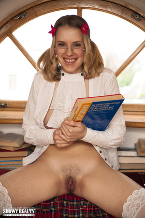 Blonde school girl wearing pigtails and glasses opens her white blouse and shows her hot tits before she removes her green and red checkered skirt and white panty and reveals her nasty crack on a maroon and white couch wearing her white stockings. - XXXonXXX - Pic 15