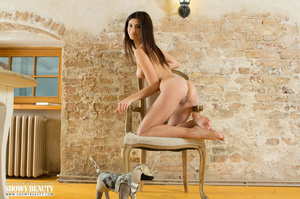 Gorgeous hottie slowly takes off her white blouse with multi-colored designs, vari-colored skirt and pink underwear then displays her luscious body with indulging tits and sweet pussy on a white chair. - XXXonXXX - Pic 16