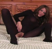 Brown-haired madame has a lot of pantyhose in her wardrobe