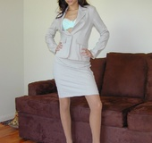 Attractive office worker takes her jacket and skirt off