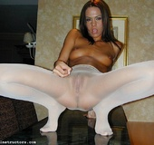 Hot babe tries blue and white pantyhose in the living room