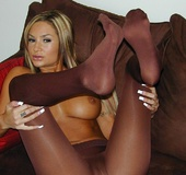Brown tights and big melons of blonde dame attract attention
