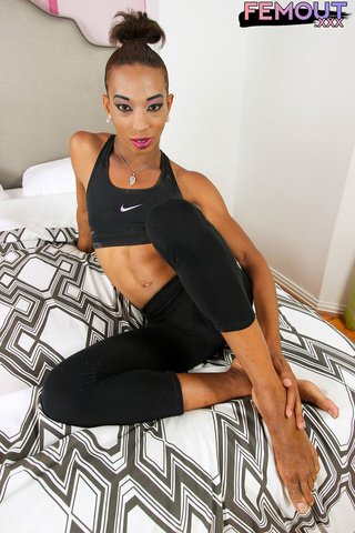 sporty shemale shows ass
