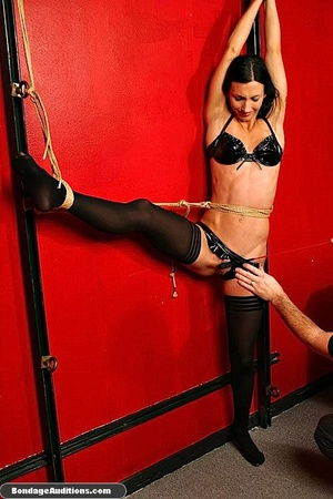 Tied up beauty gets a really painful cun - Picture 6