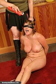 tied gal gets blindfolded