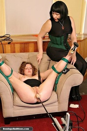 mistress with strap-on dominates