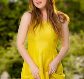 Yellow sundress comes off a beauty in a serene outdoor strip session.