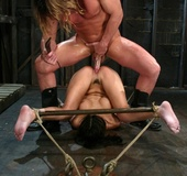 Tarzan-style dude attacks tied up babe with tongue and dick